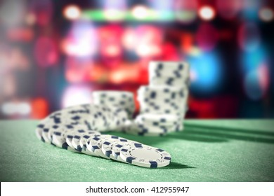 green table background of casino chips