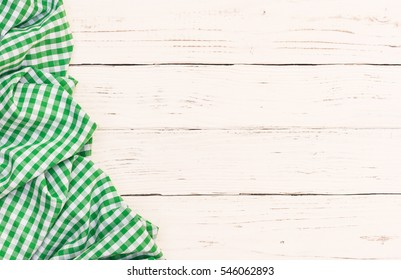 Green tablecloth on white table background, top view, copy space.