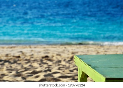 Green tables on the beach