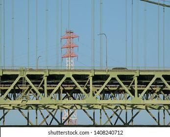 green tacoma narrows bridge under sky in summer