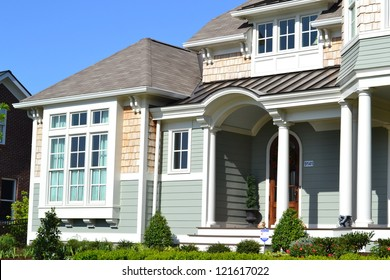 Green and Tan Suburban American Cape Cod Home with Large Front Porch
