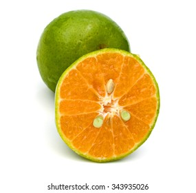 green tangerine on white background