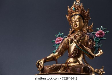 Green Tara - the embodiment of active love and sympathy of Buddha. The figurine made of bronze. Isolated on a gray background.