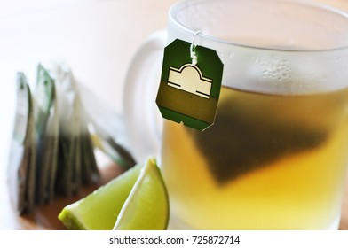 Green tea with tea bags and limo