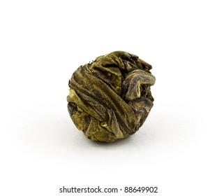 Green tea balls against a white background