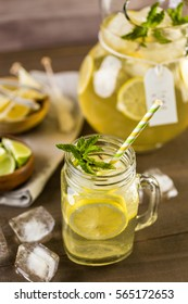 Green tea with citrus in drinking mason jar with ice.