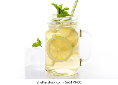 Green tea with citrus on a white backgound.