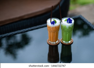 Green tea and cold milk tea on the table