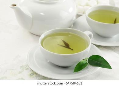 Green tea cup and tea pot
