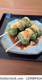 Green tea Dango dessert with with Brown Sugar Syrup and Kinako ( Roasted Soy Flour ) serve on plate.