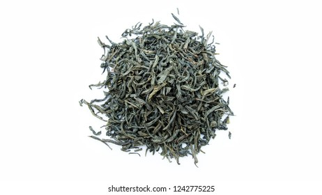 Green tea dried leaves, composition isolated over the white background. Top view, Selective focus, Horizontal image.