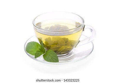 Green tea in glass cup with pepper mint isolated on white background