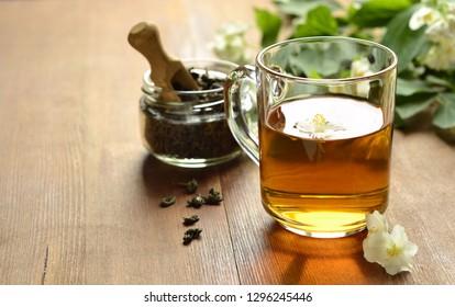 Green tea with jasmine blossom, copy space