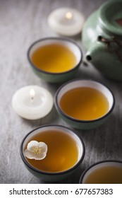 Green tea with Jasmine flower and candles in ceramic Chinese.