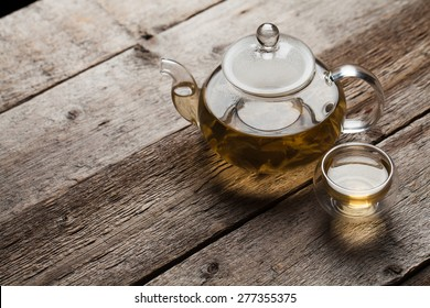 Green tea with jasmine a in a glass teapot