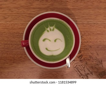 Green tea latte with smiley face Art Deco. Coffee has been chosen as world favorite drinks.
