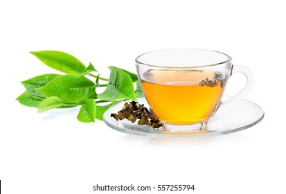 green tea leaf with a glass of tea on white background