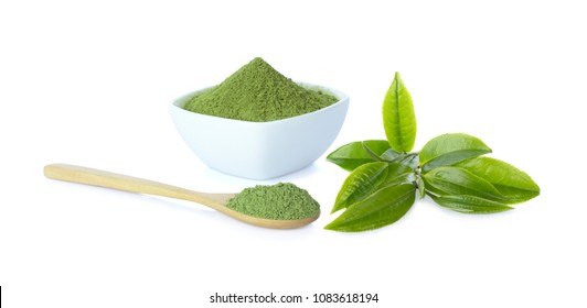 Green tea leaf and matcha powder in cup and spoon isolated on white background.
