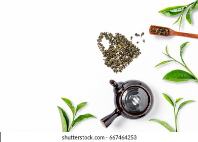 Green tea, green tea leaf and tea pot on white background. top view