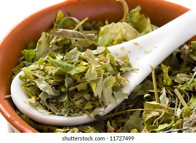 Green tea leaves in a bowl