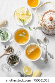 Green tea with lemon, ginger, sage on a light background, top view. Healthy detox drink. Flat lay