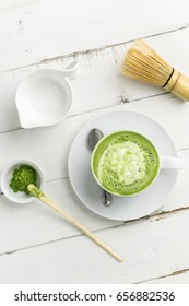 Green tea matcha latte vertical top view. This latte is a delicious way to enjoy the energy boost & healthy benefits of matcha. Matcha is a powder of green tea leaves packed with antioxidants.