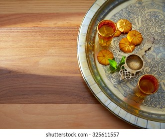 green tea with mint Moroccan style on silver tray and biscuits