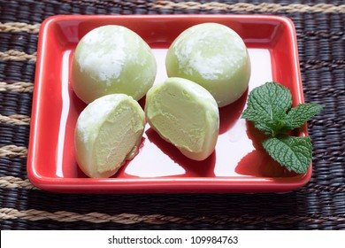 Green tea mochi ice cream on red plate
