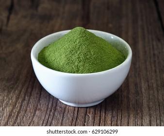 Green tea powder in cup