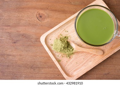 green tea and green tea powder on wooden background