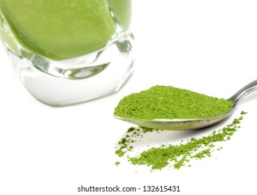Green tea smoothie and matcha. Focus is on the matcha