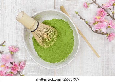 Green  tea . Still life with green tea powder and bamboo whisk. Japanese Tea Ceremony: Preparation of powdered green tea