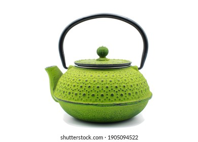 green teapot isolated on a white background. concept: tea