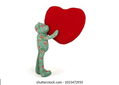 Green Teddy bear holds in paws red heart