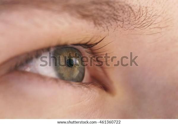 green teen girl eye closeup side view