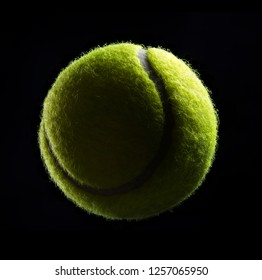 green tennis ball isolated on black
