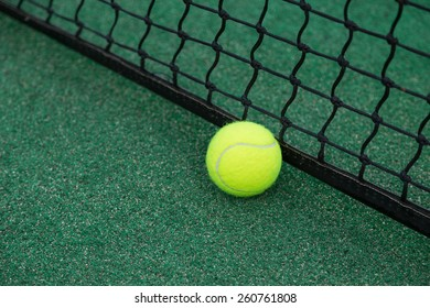 green tennis  ball on court