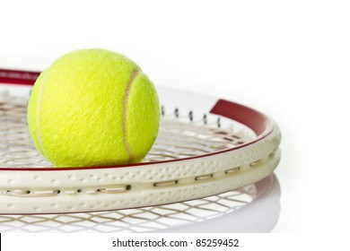 Green tennis ball on the red racket