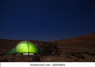 Green tent lighting at night