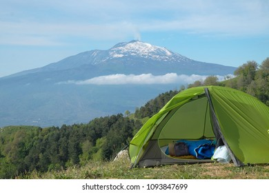 green tent on peak of Malabotta Woods in front of Etna Volcano, Sicily