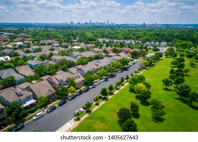 green Texas landscape in central Texas , Suburbs , rows of new houses with solar panels and renewable energy efficiency homes in Austin Texas