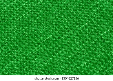 Green textile background with visible details