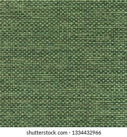 Green textile textured background. Vintage fashion background for designers and composing collages. Luxury textured genuine fabric of high and natural quality.