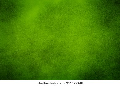 Green texture background with bright center spotlight