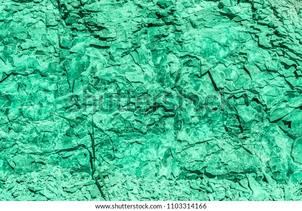 green texture relief of an old destroyed granite stone, geology abstract background