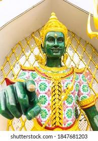 Green thai god forward point finger