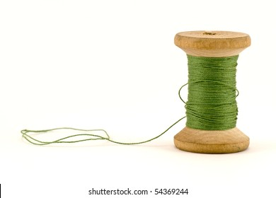 green thread spool , isolated on white background