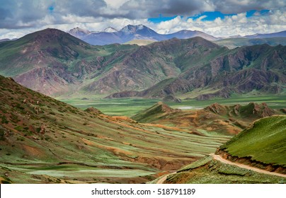 Green tibetan landscape on the road from Saga, Central Tibet