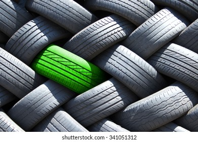 Green tire in a stack of tires