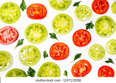 Green tomato slices with basil on white background top view